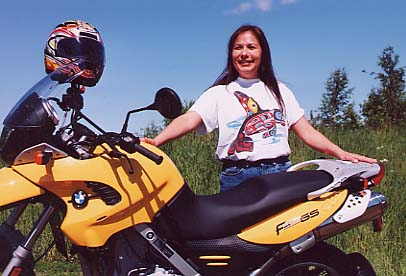 A pretty new motorcycle being taken home by a pretty Alaska Native.