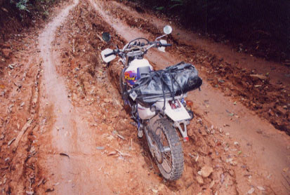 Wet Thai jungle mud is more slippery than K-Y Jelly on glass and an error in judgement found my motorcycle high-centered in a two-foot deep rut.