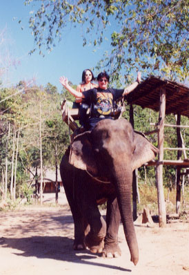 Not all the adventure in Thailand is atop motorcycles on empty, perfect roads. Here I am sharing an elephant ride with Japanese motorcyclist and journalist Akiko Kishimoto.